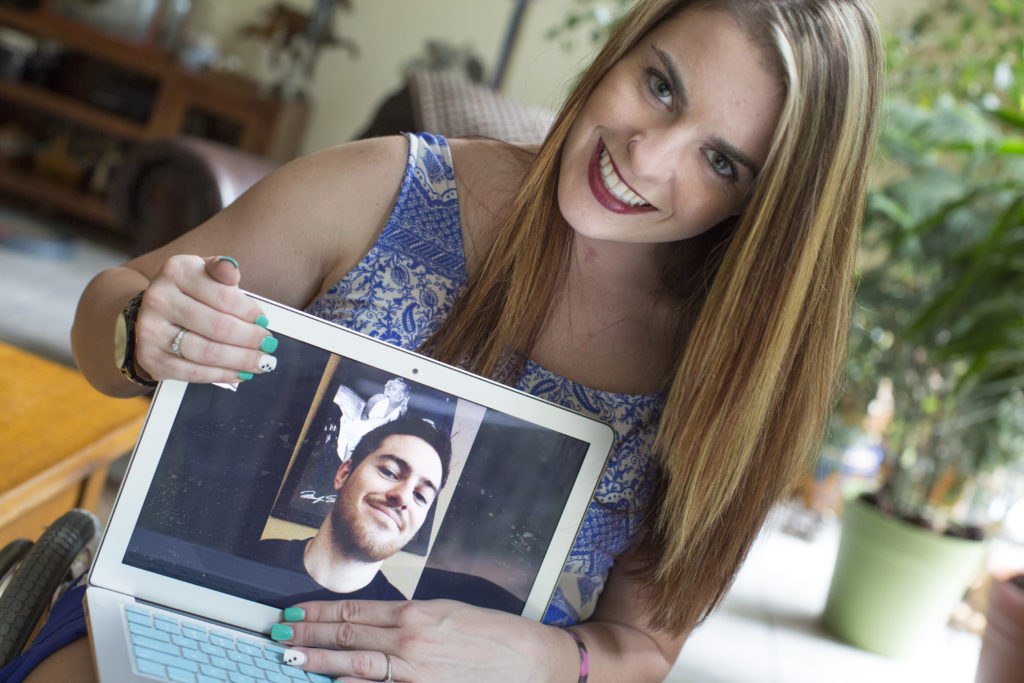 Jesi Stracham, 23, of Iron Station, NC was in a motorcycle accident January that left her paralyzed from the waist down. Stracham is taking part in clinical trials called the InVivo Neuro Scaffold which possibly may get her walking again. She fell in love with another paralyzed patient Jordan Fallis (pictured), 26, of Peoria, AZ, who is undergoing the same treatment. The pair met at the 2015 Boston Marathon and frequently video chat. (Jason E. Miczek for The Boston Globe)