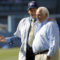 Philanthropist Michael Milken talks with former Los Angeles Dodgers manager and Special Advisor to the Chairman, Tom Lasorda, on the field before a baseball game against the San Francisco Giants in Los Angeles, Sunday, June 21, 2015. (AP Photo/Alex Gallardo)