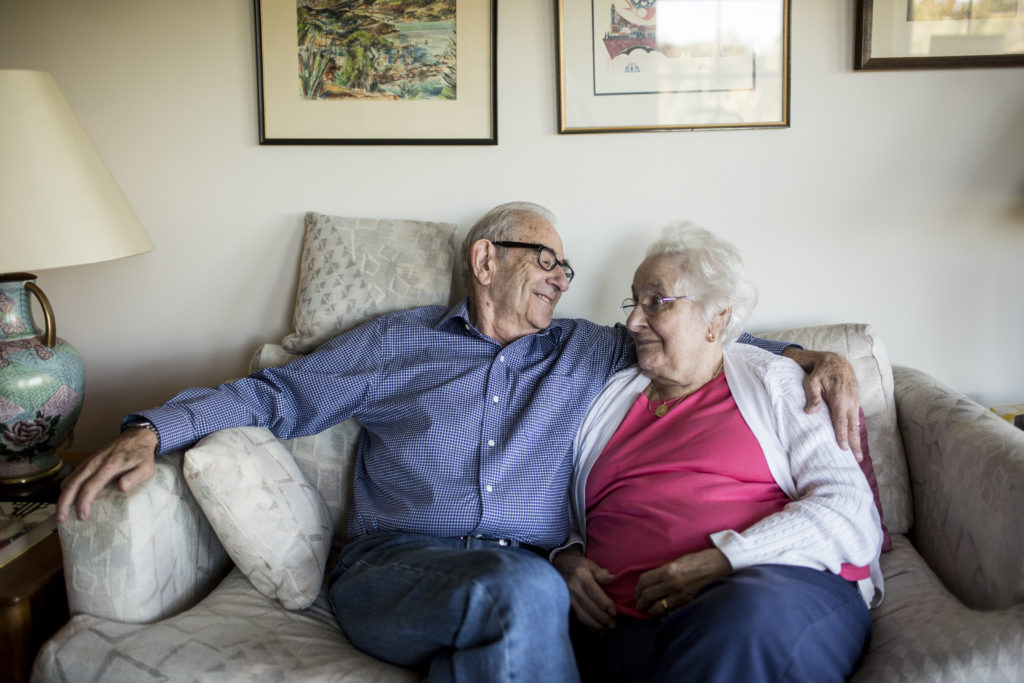 Sumner and Joyce Richman in the living room of their apartment in North Oaks, Minn., on Thursday, Oct. 1, 2015. Sumner takes care of his wife of more than 60 years in their apartment at the Waverly Gardens senior facility outside of St. Paul, MN. Despite the face that Joyce has Alzheimer's disease, the two are able to stay in the same apartment in the care companion unit at the facility. (Jenn Ackerman for STAT) Photo by Ackerman + Gruber