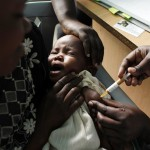 "FILE - In this Oct. 30, 2009 file photo, a mother holds her baby as she receives a new malaria vaccine as part of a trial at the Walter Reed Project Research Center in Kombewa in Western Kenya. The European Medicines Agency is recommending that the world's leading malaria vaccine be licensed even though it is only about 30 percent effective and that protection fades over time. In a statement published on Friday, July 24, 2015, the agency said it had ""adopted a positive scientific opinion"" for the vaccine's use outside the European Union, a regulatory process that helps speed new medicines to the market. The vaccine, known as Mosquirix and made by GlaxoSmithKline, protects only about one-third of children though it might help protect some kids from getting the parasitic disease. (Karel Prinsloo/AP/File)"