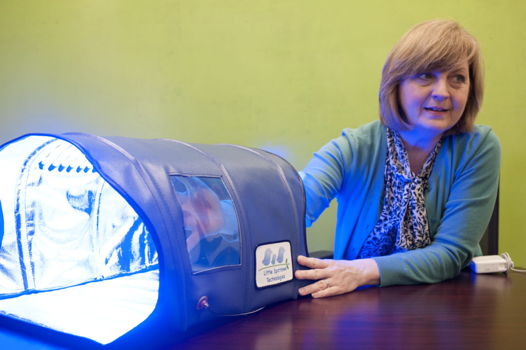 Dr. Donna Brezinski demonstrates a prototype of the Bili-Hut, a device she designed to deliver light therapy treatments to newborns with jaundice, in Boston, Oct. 22, 2015.