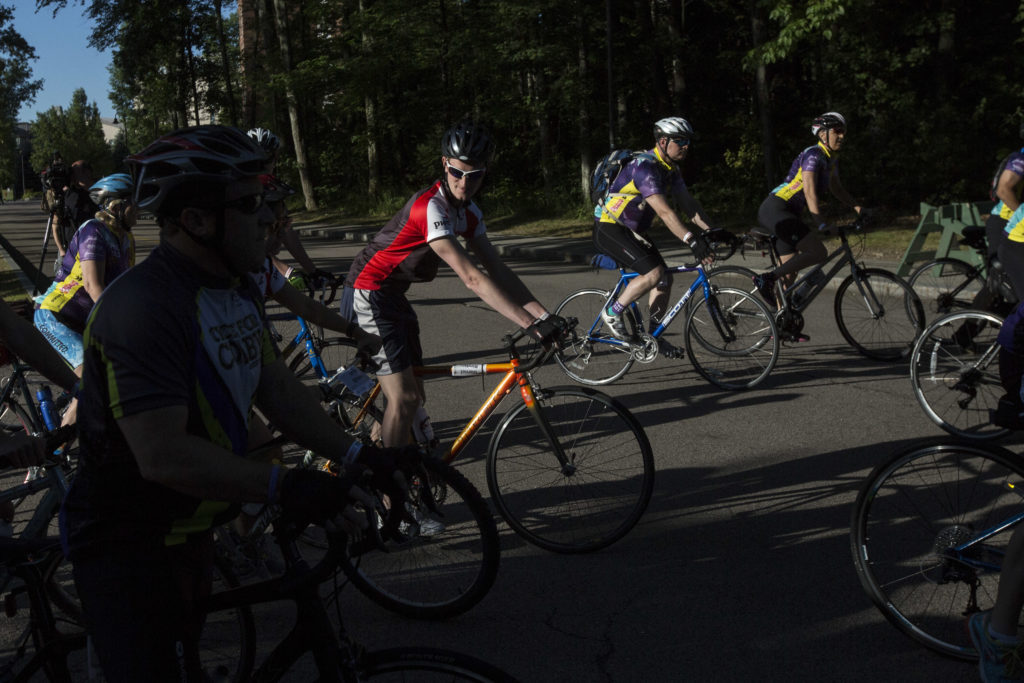 Riders take part in the Pan-Mass Challenge in Wellesley, Mass., Aug. 2, 2015.
