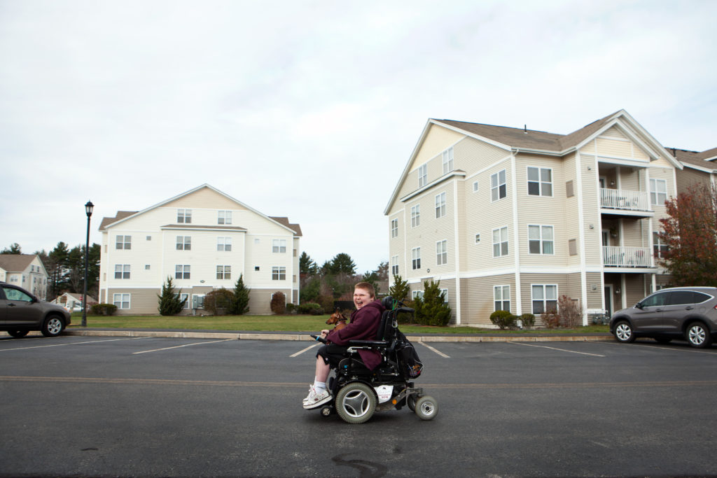 Austin Leclaire, 16, makes his way through his apartment complex to the dog park, in Pembroke, Mass. Austin and his brother Max have Duchenne muscular dystrophy, and are taking an experimental drug that has had a positive impact on their quality of life.