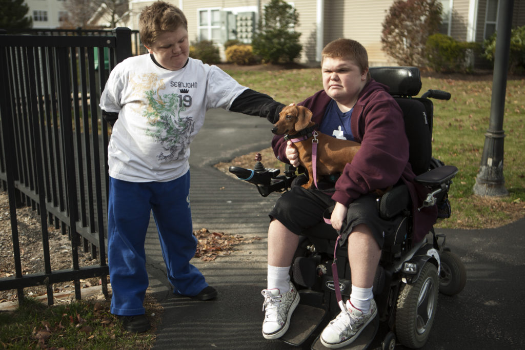 Max, left, 13, and Austin Leclaire, 16, outside of their apartment in Pembroke, Mass.. Both boys have Duchenne muscular dystrophy, and are taking an experimental drug.