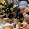 Bob Shoudt, 39, of Royersford, Pa., right, eats his turkey as he participates in the GoldenPalace.com Thanksgiving Invitational turkey eating contest in New York, Wednesday, Nov. 23, 2005. Each of the eight contestants was given a 10-pound turkey to consume in 12 minutes. Competitors are, from left, Ed Jarvis from New York,  Joey Chestnut from San Jose, Calif, Sonya Thomas from Alexandria, Va., and Eric Booker from New York. Thomas was the winner of the competition eating 4 pounds 3.1 ounces of turkey. Shoudt came in fifth place consuming 3 pounds 9.1 ounces of turkey. (AP Photo/Tina Fineberg)