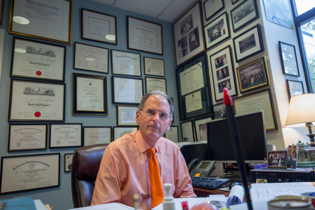 Oct. 21, 2015 - Dr. Martin Samuels, chair of neurology at Brigham and Women's Hospital, poses in his office in Boston, Mass. Photo Credit: Justin Saglio.