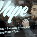 Eric Scheman demonstrates an e-cigarette at Vape store in Chicago, Wednesday, April 23, 2014. The federal government wants to ban sales of electronic cigarettes to minors and require approval for new products and health warning labels under regulations being proposed by the Food and Drug Administration. (AP Photo/Nam Y. Huh)