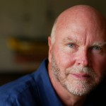 Biologist J. Craig Venter poses at his home in Alexandria, Va., July 1, 2005. Venter has formed a new company that will try to manufacture organisms for industrial purposes by piecing together a genes, the building blocks of life. The goal is to cobble together the genes of single-cell life forms that can perform tasks such as cleaning up hazardous waste, removing carbon dioxide spewed out by power plants or creating new drugs.