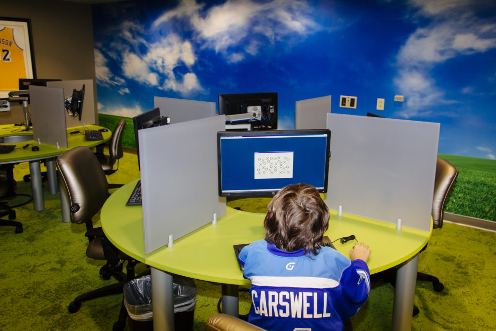James Carswell, 13, takes an ImPACT test on a computer inside of the Concussion Clinic at the Providence St. Joseph Medical Center in Burbank, California. Carswell received a concussion playing hockey and Dr. Michael Marvi treated him and used the ImPACT test to establish a baseline and to determine when he had healed and was fit to play again safely.