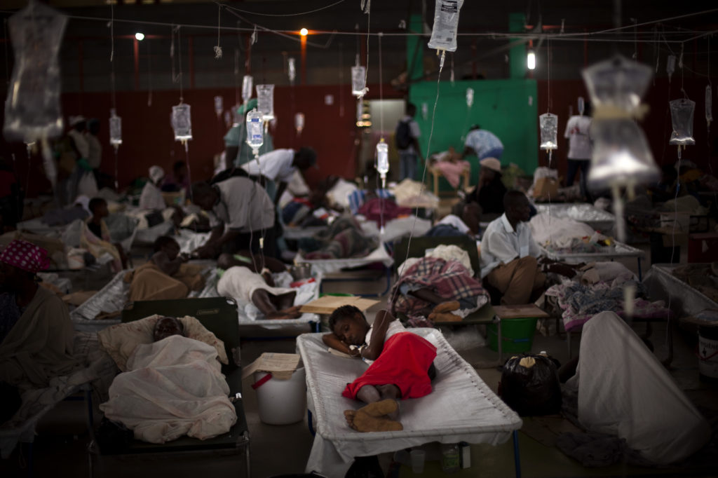 People suffering cholera symptoms are treated in a sports center converted into a cholera treatment center in Cap-Haitien, Haiti, in 2010.