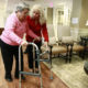 Alexis McKenzie, executive director of The Methodist Home of the District of Columbia Forest Side, an Alzheimer's assisted-living facility, walks with resident Catherine Peake, in Washington, Monday, Feb. 6, 2012. Dementia can sneak up on families because its sufferers are pretty adept at covering lapses early on, longer if their spouses are there to compensate. Doctors too frequently are fooled as well. Now specialists are pushing for the first National Alzheimer's Plan to help overcome this barrier to detection _ urging what's called dementia-capable primary care, more screenings for warning signs, and regular checks of caregivers' own physical and mental health.  (AP Photo/Charles Dharapak)