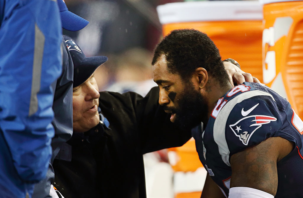 New England Patriots corner back Darrell Revis is checked for symptoms with the NFL Sideline Concussion Assessment during the NFL AFC Championship game between the Indianapolis Colts and the New England Patriots, Jan. 18, 2015.