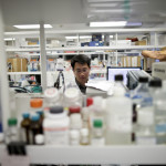 In this March 4, 2015 photo, research scientist Tony Huang works in a laboratory at Vertex Pharmaceuticals Inc. in San Diego. The global pharmaceutical industry is pouring billions of dollars into developing treatments for rare diseases, which once drew little interest from major drugmakers but now point the way toward a new era of innovative therapies and big profits. Vertex hopes to have treatments for roughly 90 percent of cystic fibrosis patients by around 2020. (AP Photo/Gregory Bull)