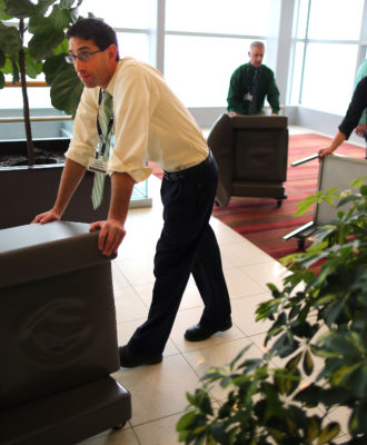 Brigham and Womens workers move furniture