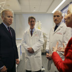 CORRECTS LAST NAME FROM LIVINE TO LEVINE- Vice President Joe Biden, left listens to Dr. Amy Gutmann, right, speak as Dr. Bruce L. Levine PH.D., center, and Dr. Carl H. June M.D., second from right,  Friday Jan. 14, 2016, in the Abramson Cancer Center at the University of Pennsylvania in Philadelphia. (AP Photo/ Joseph Kaczmarek, Pool)