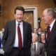 Senate Health, Education, Labor and Pensions Committee Chairman Sen. Lamar Alexander, R-Tenn., right, speaks with Dr. Robert Califf.,  President Barack Obama's choice to lead the Food and Drug Administration (FDA), talk on Capitol Hill in Washington, Tuesday, Nov. 17, 2015, prior to the committee's hearing on Califf's nomination. (AP Photo/Pablo Martinez Monsivais)