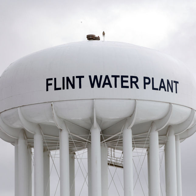5 people, including Michigan health chief, charged in Flint