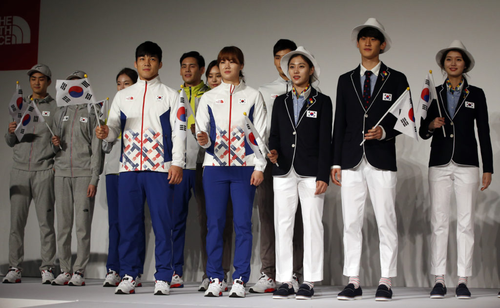 South Korean Olympic athletes and models present the South Korean Olympic team uniforms for the 2016 Rio de Janeiro Olympic Games at Korean National Training Center in Seoul, South Korea, Wednesday, April 27, 2016. South Korea's Olympic committee on Wednesday unveiled long-sleeved shirts and pants it says will help protect the country's Olympic athletes from the mosquito-borne Zika virus at this year's games in Rio de Janeiro. (AP Photo/Lee Jin-man)