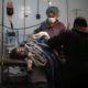 Surgeons prepare a young girl for surgery following an air strike near Douma, Syria.