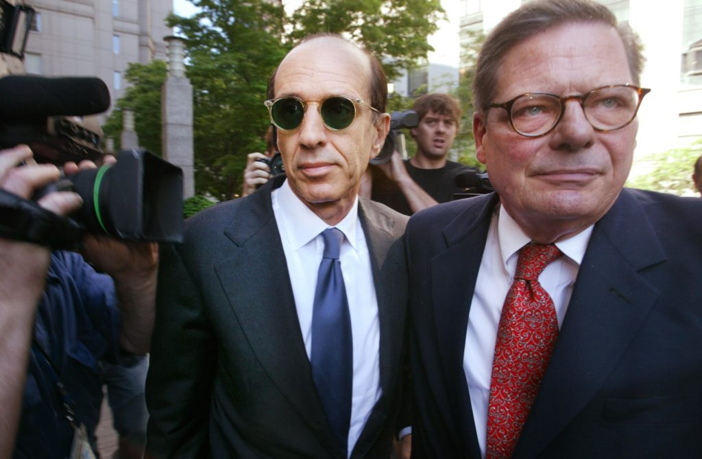 NEW YORK - JUNE 10: ImClone Systems Inc. founder Samuel Waksal (L) and an aide enter federal court for sentencing June 10, 2003 in New York City. Waksal faces up to 75 years in prison and large fines for insider trading charges sales tax evasion. (Photo by Chris Hondros/Getty Images)