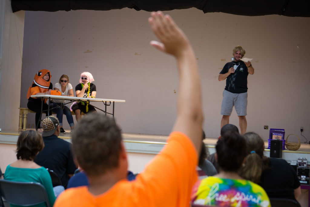 Fall River, MA -- 08/01/16 -- A participant raises his hand while members of the Trauma Drama troupe perform an interactive therapeutic theatrical exercise on-stage during a Trauma Drama session on August 1, 2016, in Fall River, Massachusetts. (Kayana Szymczak for STAT)