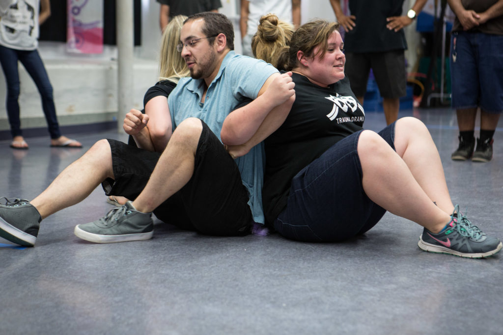 Fall River, MA -- 08/01/16 -- Trauma Drama troupe members Simon Davis-Millis (left) and Nicole Craig (right) demonstrate an interactive therapeutic game to Trauma Drama participants on August 1, 2016, in Fall River, Massachusetts. (Kayana Szymczak for STAT)
