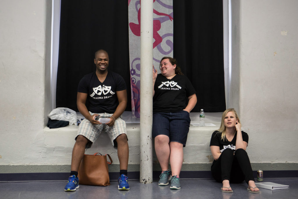"Fall River, MA -- 08/01/16 -- L-R: Trauma Drama troupe members Dave Dorvilier, Nicole Craig, and Kristen Cahill, watch as troupe members rehearse an interactive, therapeutic theatre piece with the theme ""family neglect"", that they will be performing during next week's Trauma Drama session. (Kayana Szymczak for STAT)"