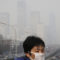 FILE - In this Dec. 20, 2015 file photo, a woman wearing a mask for protection against pollution walks on a pedestrian overhead bridge as office buildings are shrouded with smog in Beijing. More than nine out of 10 people worldwide live in areas with excessive air pollution, contributing to problems like strokes, heart disease and lung cancer, the World Health Organization said Tuesday, Sept. 27, 2016. The U.N. health agency said in a new report that 92 percent of people live in areas where air quality exceeds WHO limits, with southeast Asia, eastern Mediterranean and western Pacific regions hardest hit. (AP Photo/Andy Wong, File)
