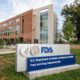 FILE - This Oct. 14, 2015, file photo shows the Food and Drug Administration campus in Silver Spring, Md. The FDA on Monday, Sept. 19, 2016, granted tentative approval to the first drug for muscular dystrophy, following an intense public campaign from patients and doctors who pushed for the largely unproven medication. The FDA cleared Sarepta Therapeutics' Exondys 51 for a rare form of Duchenne muscular dystrophy, a deadly inherited disease that affects boys.