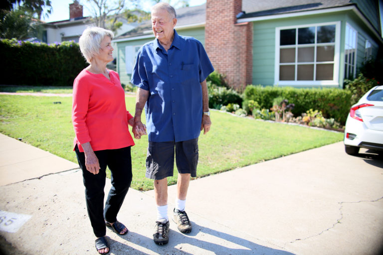 Biff Flanagan, an esophogeal cancer patient, on a walk with his wife Patricia at their home in San Diego, Calif.