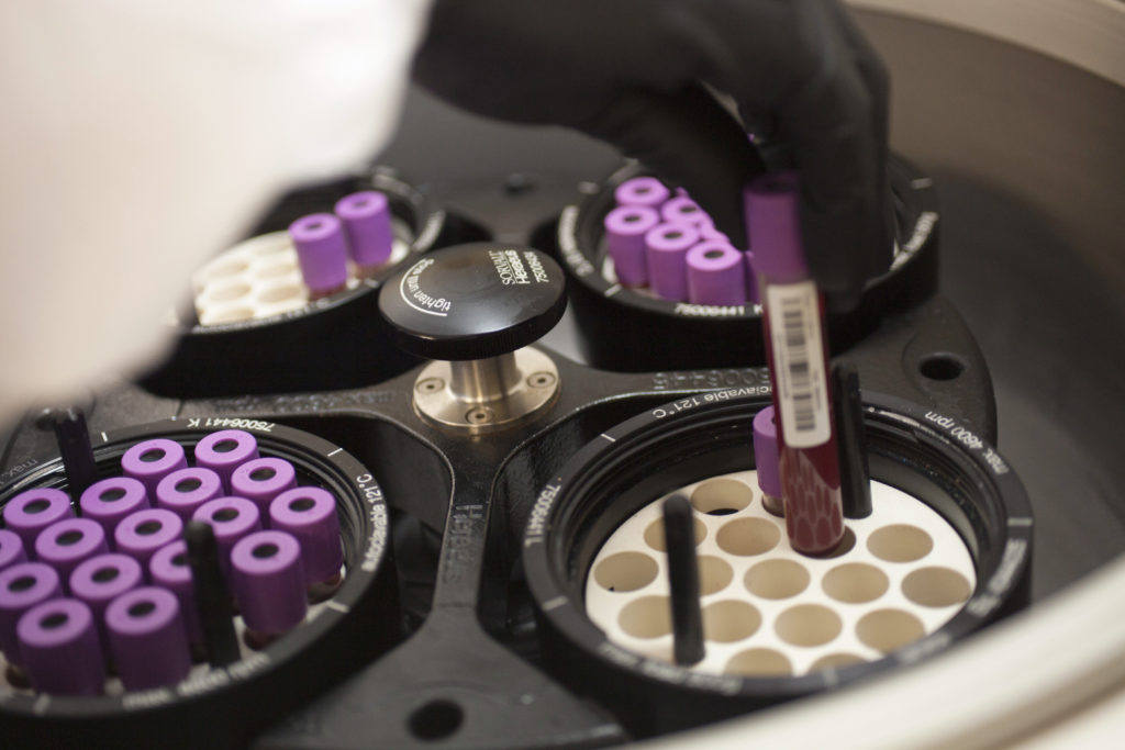 Blood samples are loaded onto a centrifuge in the Core Laboratory at the Massachusetts Veterans Epidemiology Research and Information Center at the Veterans Affairs hospital in the Jamaica Plain neighborhood of Boston.