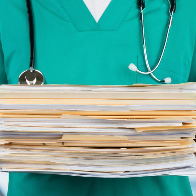 Doctor w paperwork