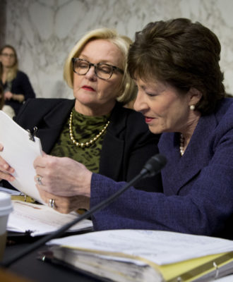 Sen. Susan Collins, R-Maine, and Sen. Claire McCaskill, D-Mo., confer on Capitol Hill.