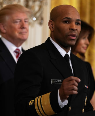 Jerome Adams with Trump and Melania