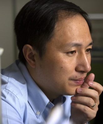 He Jiankui looks at a computer screen