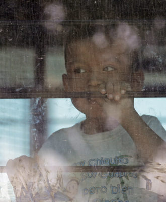 Child on U.S. Border Patrol bus