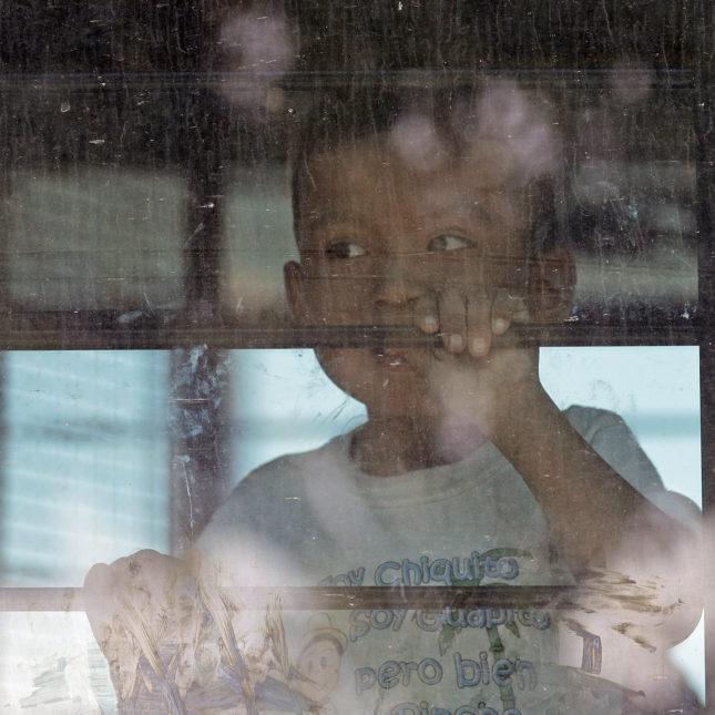Child on U.S. Border Patrol bus