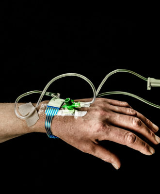 IV hand black background