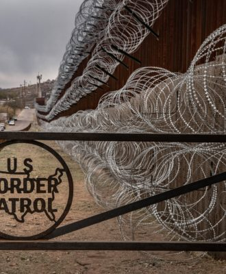 Border fence with barbed wire