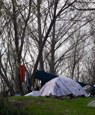 A tent in a homeless encampment
