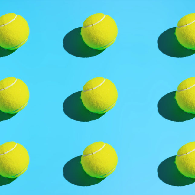 tennis balls on a blue background