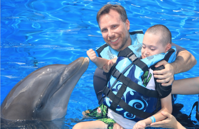 Buddy Might with dolphins