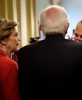 Senator Elizabeth Warren (D-MA) (L), Senator Bernie Sanders (I-VT) (2L), Senate Minority Leader Chuck Schumer (D-NY) (3L), Senator Tammy Baldwin (D-WI)