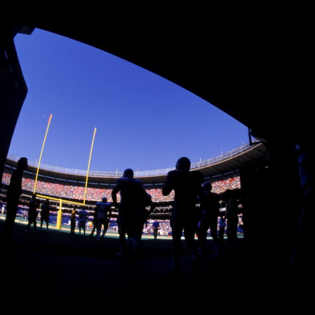 Silhouetted NFL players