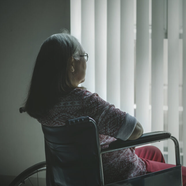 Elderly patient looking out window