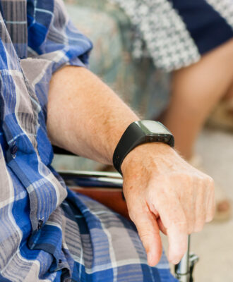 elderly man wearing smart watch
