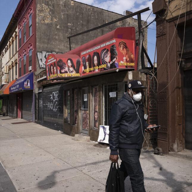 Man walking in Bedford Stuyvesant neighborhood