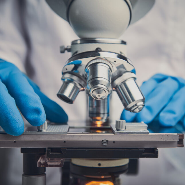 microscope and blue gloves