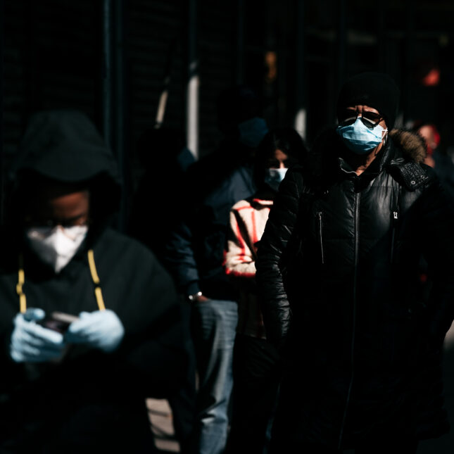 Pedestrians wear face masks NY