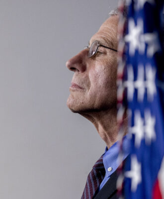 Fauci w/ flag scientists